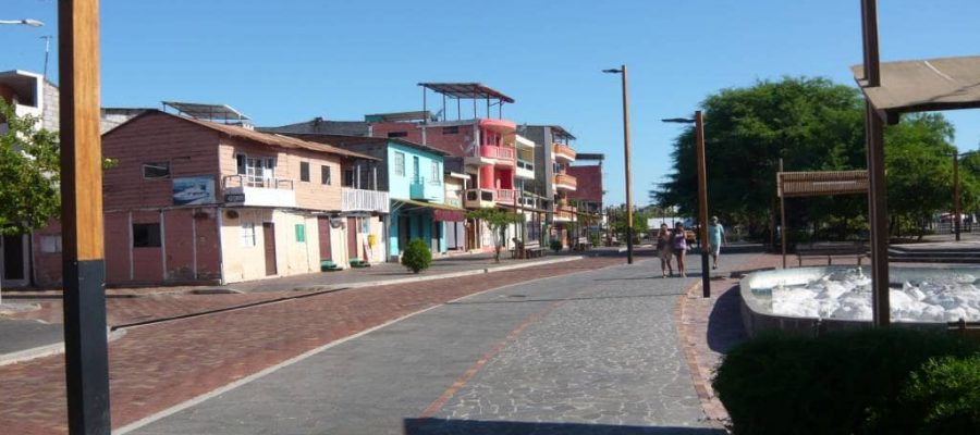 san cristobal's main street is lined with colourful businesses