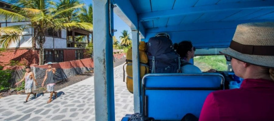 take the bus along the sandy roads of Isabela Island